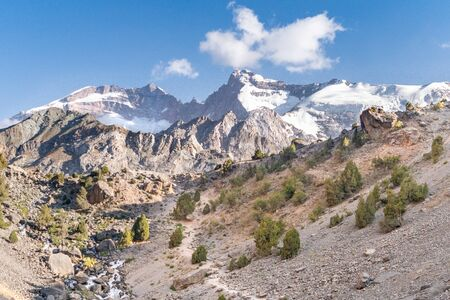 The beautiful mountain treking road with clear blue sky and rocky hills in Fann mountains in Tajikistan