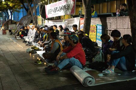 Seoul/South Korea-18.10.2016:The people sitting on the street and taking a part in demonstration Фото со стока