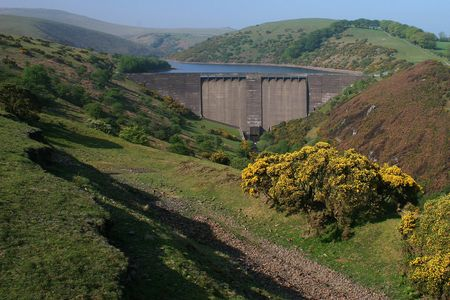 qua: Meldon dam on the North Western slopes of Dartmoor was built in 1972 to supply water to the rapidly expanding town of Okehampton, the reservoir flooded an ancient mining and quarrying valley, downstream from the dam is the large open expanse of Meldon qua