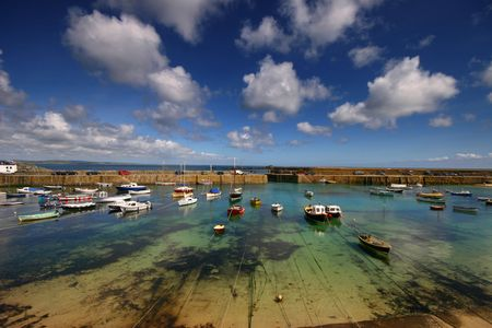Summertime at the quaint fishing port of Mousehole, West Cornwall, United Kingdom. photo