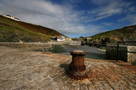 owes: Mullion cove on the Lizard peninsula Cornwall owes its being to the fishing trade, the small harbour provides shelter for a small fishing fleet was completed in 1895. There was a lifeboat stationed at Mullion from 1867 until 1909. Stock Photo
