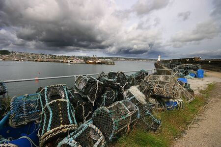 Newlyn harbour in West Cornwall, is one of the UKs largest fishing ports with a history spanning over seven centuries. photo