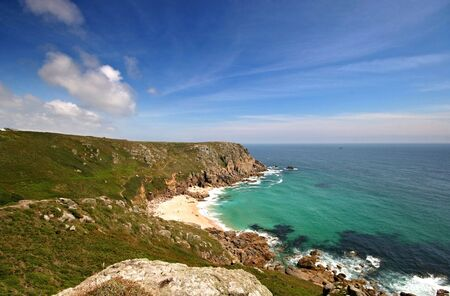 porthcurno: Porthchapel beach in West Cornwall in a fairly secluded south facing sandy beach which is situated between Porthgwarra and Porthcurno, the beach is covered in a coarse golden sand which is mainly shell in makeup, the beach is fairly difficult to access th