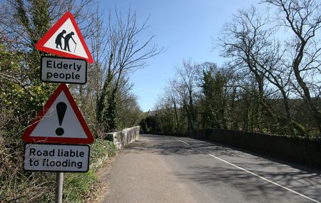 The juxtaposition of these two road signs must of been lost on the workers that ercted it in a Devonshire lane, UK photo