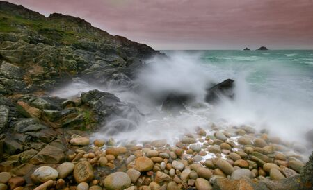 stormy waters: A long exposure turned the stormy waters of Cot Valley into a smooth form. Stock Photo