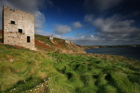 The engine houses of wheal trewavas on the East Rinsey Cliff in west cornwall, looking towards Porthleven photo