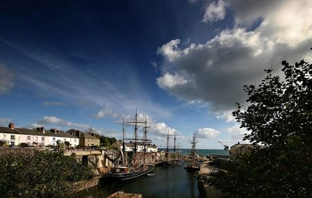conjunction: Charlestown harbour is situated approximately two miles from St Austell, the harbour and the surrounding houses have changed very little in their lifetime, this in conjunction with the tallships in its harbour gives an old world atmosphere to this quaint  Stock Photo