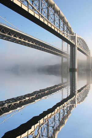 These are the two main bridges that join the counties of Devon and Cornwall in the UK, the river is called the river Tamar