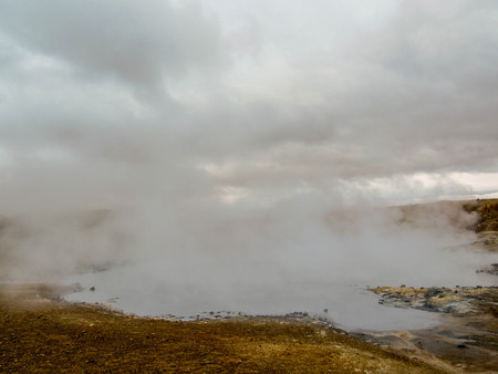 Beautiful landscape of steaming lake in Krýsuvík, Seltun in good sunny day with blue sky, Reykjanes Peninsula, Global Geopark, Geothermal active area on southwest of Iceland, Europe Stock fotó