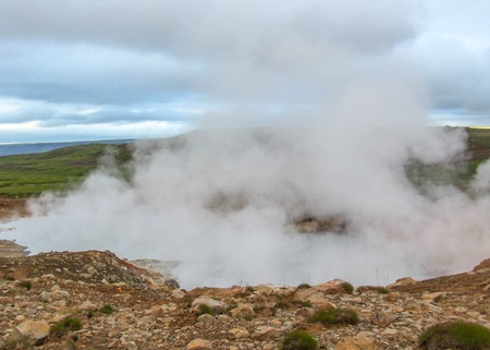 Unearthly view of steaming lake in Krýsuvík, Seltun in good sunny day with blue sky, Reykjanes Peninsula, Global Geopark, Geothermal active area on southwest of Iceland, Europe