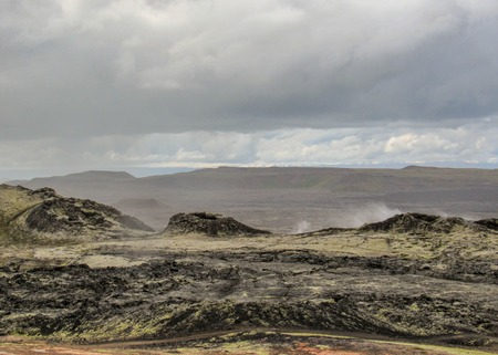 Epic landscape with dry stiff black lava, still steaming in Krafla volcanic caldera and fissure zone, Myvatn region. Popular tourist destination of Diamond circle in northern Iceland, Europe