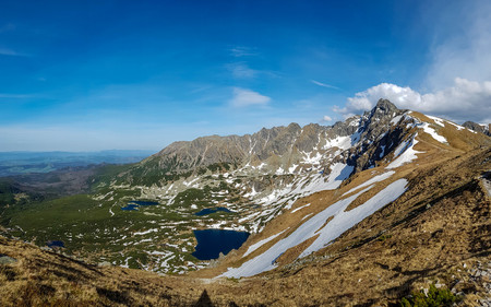 Stunning landscape with mountain lake Czarny Staw with a distinctive blue color surrounded by mountains.Popular hiking destination from Zakopane, Poland, Europe