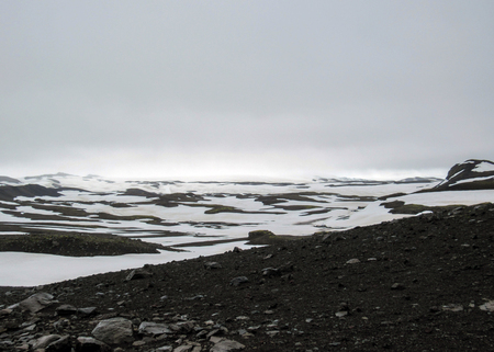 Epic naturally white&black landscape of Fimmvorduhals between glaciers Eyjafjallajokull and Myrdalsjokull in foggy summer day, Fimmvorduhals Trek from Skogar to Thorsmork, Highlands of Iceland
