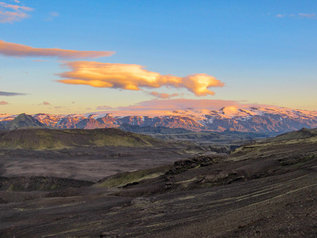Volcanic landscape with Eyjafjallajokull and Myrdalsjokull glaciers terrain under sunset sky in summer night, Katla caldera, Botnar-Ermstur, Laugavegur Trail from Thorsmork to Landmannalaugar, Iceland