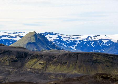 Stunning landscape of volcanic terrain with Myrdalsjokull ice cap in Katla caldera, view from Botnar-Ermstur hut campsite, Laugavegur Trail from Thorsmork to Landmannalaugar, Highlands of Iceland