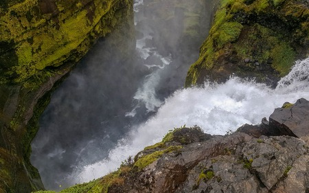 Skoga river canyon with waterfall in rainy summer day on the Fimmvorduhals Trek from Skogar to Thorsmork, Highlands of Iceland
