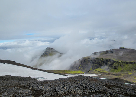 Epic landscape around plateau of Morinsheidi with mountains and glaciers in the clouds, between the Eyjafjallajokull and Myrdalsjokull in southern Iceland