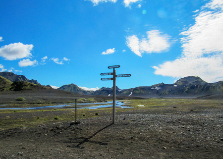Laugavegur hiking trail waymarker signpost with directions to Emstrur-Botnar, Alftavatn, Hvanngil and beautiful ethereal icelandic landscape , central Iceland Stock fotó