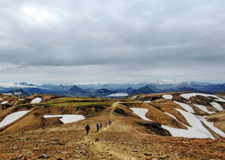Pamoramic view on Alftavatn lake, glaciers Myrdalsjokull, Eyjafjallajokull and Tindfjallajokull, black volcanic desert and mountains under snow, Laugavegur trail, Fjallabak Nature Reserve, Iceland Stok Fotoğraf