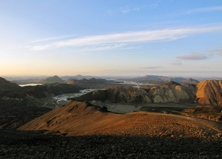 Panoramic view on popular most remote tourist destination Landmannalaugar geothemal area at sunset from the top of volcanic mountain Blahnukur, Highlands in south Iceland, Europe Imagens