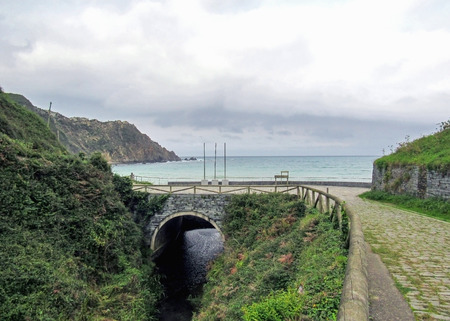 Old bridge next to the beach on Cadavedo, Asturias, Camino de Santiago Coastal route, pilgrimage of Compostela along the Northern coast of Spain Stockfoto