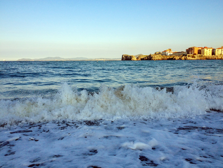 Big white waves in Castro Urdiales, Cantabrian sea coastline, Cantabria, the Major Christian pilgrimage route Camino de Santiago, the Way of Saint James, along the Northern coast of Spain