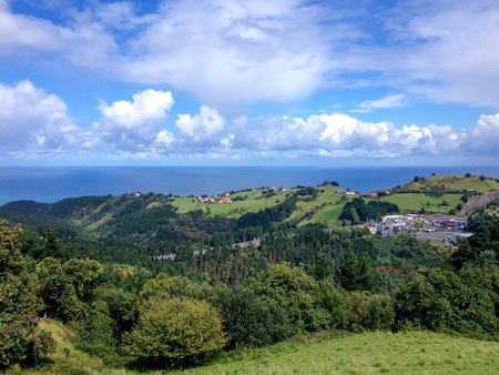 Typical view of the sea from the hills of the Pais Basco, Spain, on the camino de Santiago de Compostela, Camino del Norte or the Coastal Saint James Way, pilgrimage route in the Northern Spain Reklamní fotografie