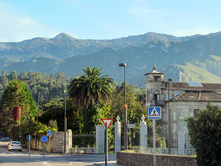 Llanes, Asturias, Spain - September, 2018: Beautiful streets of Llanes with Picos de Europa mountain range on the background, along the coastal Camino de Santiago, Northern St. James Way Redakční