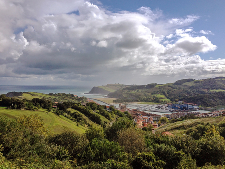 Epic landscape of the sea coast of Zumaia, Pais Basco, with a dramatic sky, Camino del Norte or the Northern Saint James Way, pilgrimage route along the Northern coast of Spain