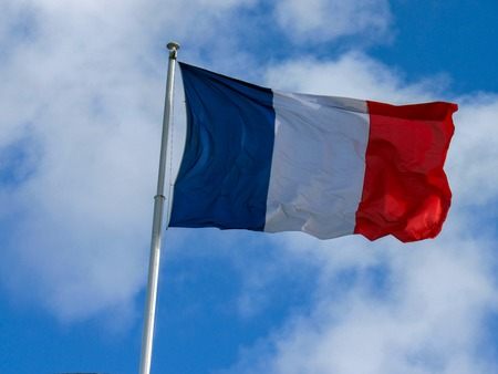 Deep and reach colors fabric tricolour flag of France flapping in the wind with natural blue sky background and few clouds and copy space Reklamní fotografie
