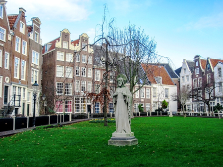 Amsterdam, Holland, Netherlands – January, 2019: Begijnhof, one of Amsterdam's oldest inner courtyards and one of the city's best known landmark with collection of historic houses
