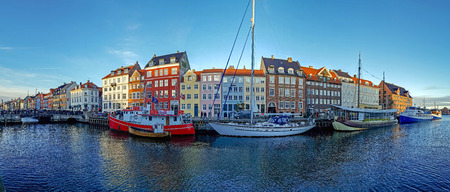 Copenhagen, Denmark - January, 2019: Picturesque Nyhavn pier with colorful houses, buildings, ships, yachts and boats in Old Town of Copenhagen, Danish capital, Popular tourist destination in Europe
