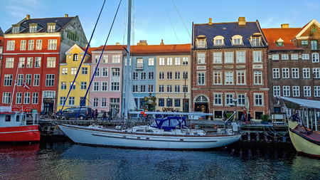Copenhagen, Denmark - January, 2019: Nyhavn waterfront, canal and entertainment district with colorful houses, buildings, ships, yachts and boats in Old Town of Copenhagen, Denmark