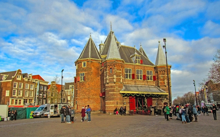 Amsterdam, Holland, Netherlands – January, 2019: Dutch architecture on the street, famous vintage traditional Flemish buildings of Amsterdam city