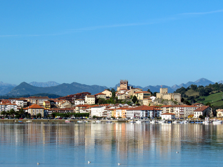 Coastal village in Cantabria, San Vicente de la Barquera reflects in mirror water,