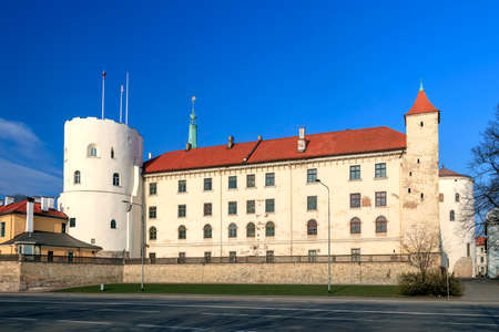 The Riga Castle in spring sunny day with blue sky, important part of the historical and cultural heritage of Latvia as one of the greatest medieval castles in Latvia Editorial