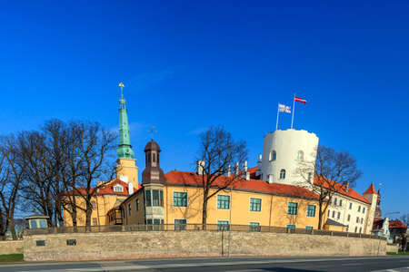 Funny cartoon style Riga Castle in spring sunny day with blue sky, Latvian government residence, official residence of the President of Latvia