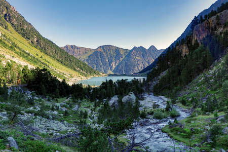 Gaube Lake, Lac de Gaube, in the Pyrenees mountains, mountain range between Spain and France. Hiking in the French Pyrenees, in the department of the Hautes-Pyrenees, near the Cauterets