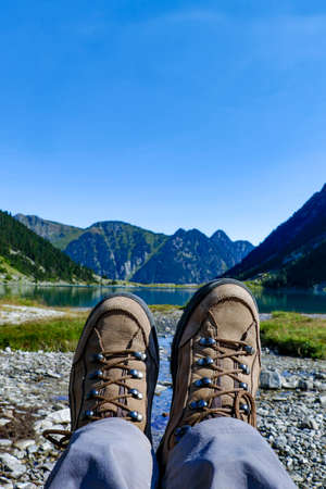 Two brown female boots near Gaube Lake, Lac de Gaube, in the Pyrenees mountains, mountain range between Spain and France, Europe Banque d'images