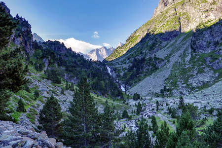 Mountain landscape in high Pyrenees with Vignemale mountain, the highest of the French Pyrenean summit and waterfall, France, Europe