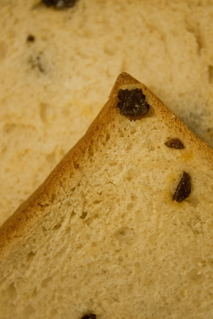 golden raisin bread with a description of expansive surfaces. photo