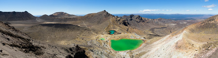 The Tongariro Crossing crosses 19 kilometers across the barren, volcanic, desert of New Zealands north island. Stock Photo