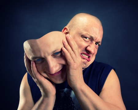 Man taking off his happy facial mask Stock Photo - 17525806