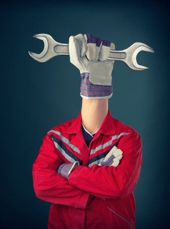 Worker with hand holding spanner instead of head Stock Photo - 17525794