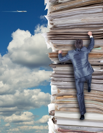 bureaucracy: Businessmen climbing up a pile of documents