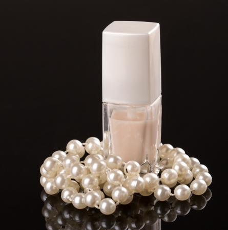 White nail polish and pearl necklace Stock Photo - 17991963