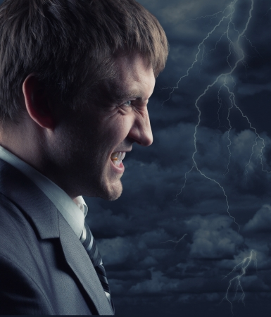 Angry businessman against storm at night Stock Photo - 17922195