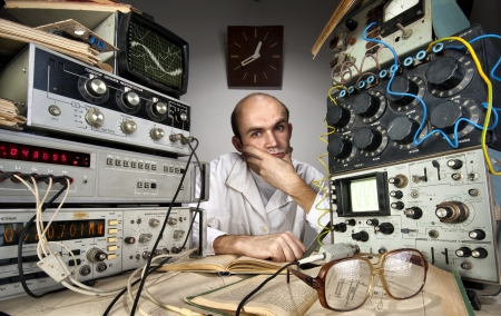 switchboard: Pensive scientist working at vintage technological laboratory Stock Photo