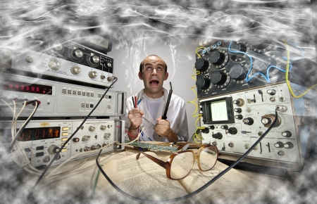 scientists: Funny nerd scientist soldering at vintage technological laboratory Stock Photo