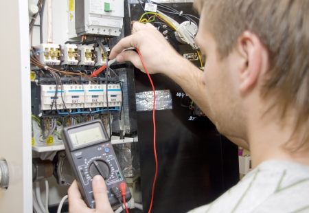 Electricista en el trabajo Foto de archivo